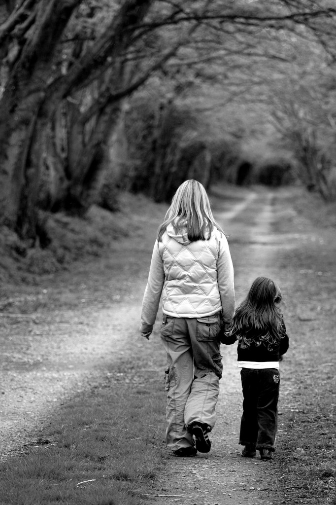 mother daughter walking